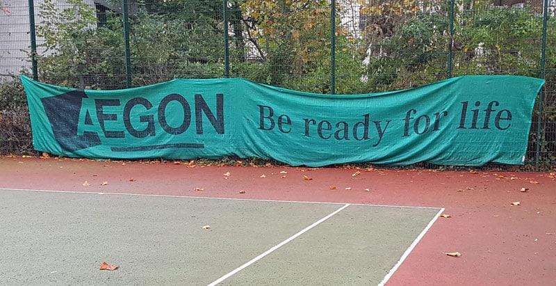 tennis court windbreak hung poorly