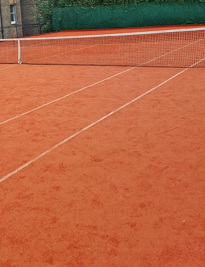 Synthetic clay court maintenance